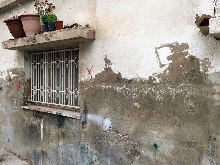 Οι τοίχοι ενός στρατοπέδου γίνονται έργο τέχνης φωτό - εικόνα 4