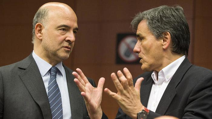 Ευκλείδης Τσακαλώτος και Πιερ Μοσκοβισί κατά τη διάρκεια συνεδρίασης του Eurogroup