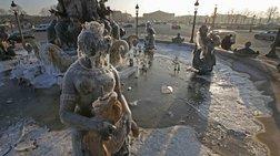 «Πάγωσαν» ακόμα και τα αγάλματα από το δριμύ ψύχος στο Παρίσι- [εικόνες]
