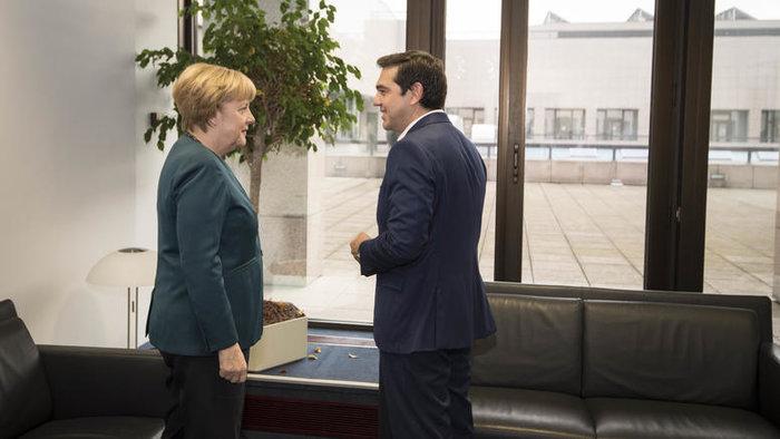 Αλέξης Τσίπρας και Άνγκελα Μέρκελ κατά τη διάρκεια της συνάντησής τους στις Βρυξέλλες