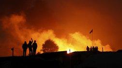 """Μεγάλη φωτιά μαίνεται στη """"ζούγκλα του Καλαί"""", ενώ συνεχίζεται η εκκένωση"""