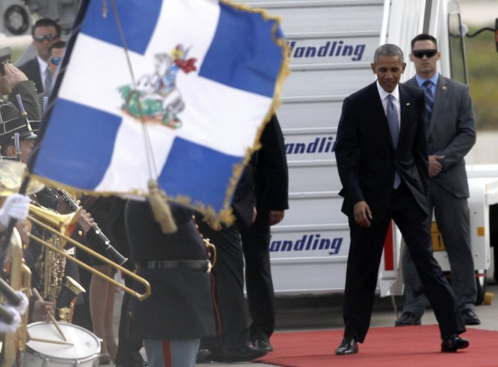 Ο Ομπάμα στην Αθήνα: Καρέ καρέ η άφιξη του 44ου Προέδρου της Αμερικής - εικόνα 7