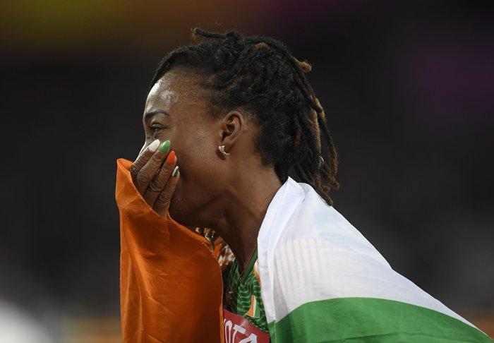 Τα χρώματα της σημαίας της Ακτής Ελεφαντοστού στα νύχια της Marie-Josee Ta Lou