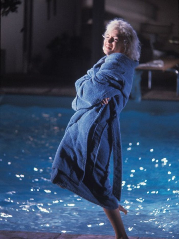 Lawrence Schiller – Marilyn Monroe (In Robe, Smiling, with Leg Up), 1962$3,500.00