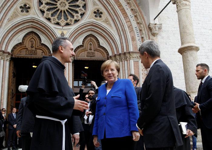 Στην Μέρκελ το Λυχνάρι για την ειρήνη του Αγίου Φραγκίσκου - εικόνα 4