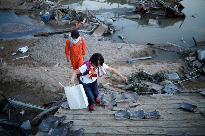 Στους 112 οι νεκροί από τις πλημμύρες στην Ιαπωνία (φωτό) - εικόνα 2