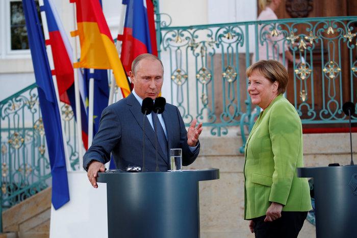 Mερκελ σε Πούτιν: Απαραίτητη η συνεργασία μας - εικόνα 3