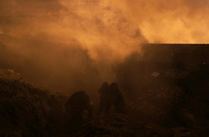 Πνίγηκε στα δακρυγόνα η προσπάθεια μεταναστών να μπουν στις ΗΠΑ (φωτό) - εικόνα 3
