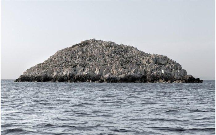 Νησιά και βραχονησίδες αναδύονται από τη θάλασσα. Εκθεση φωτογραφίας - εικόνα 4