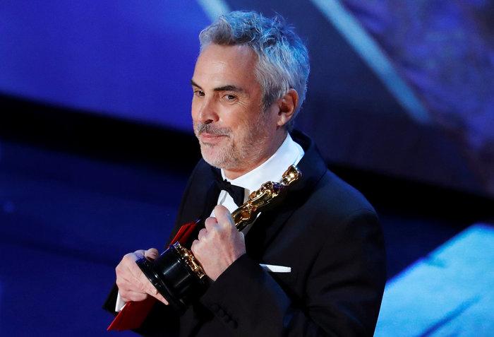 Ο μεγάλος νικητής της βραδιάς, μεξικανός σκηνοθέτης Αλφόνσο Κουαρόν.