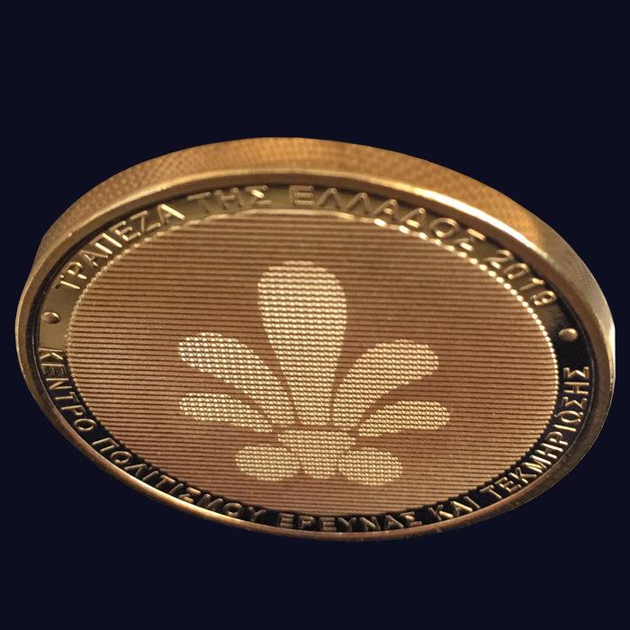 Συλλεκτικό μετάλλιο τριών όψεων
